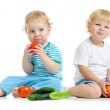 Two happy kids eating healthy food fruits and vegetables — Stock Photo