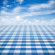 Blue tablecloth backgound  with sky — Stock Photo
