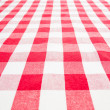 Empty table top view covered by red gingham tablecloth — Stock Photo