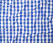 Blue and white linen tablecloth — Stock Photo