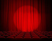 Closed theater red curtains with spotlight and seats — Zdjęcie stockowe