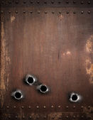 Old metal background with bullet holes — Stock Photo