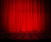 Theater red curtains and seats — Stock Photo