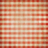 Red grunge checked gingham picnic tablecloth background — Stock Photo