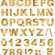 Golden or brass metal alphabet letters, digits and punctuation m — Stock Photo #35032165