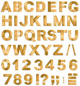 Golden or brass metal alphabet letters, digits and punctuation m — Stock Photo