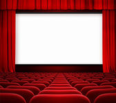 Cinema screen with open curtain and red seats — Stock Photo