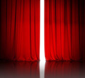 Red theater or cinema curtain slightly open and white light behi — Stock Photo
