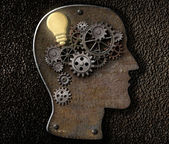 Brain mechanism made from metal cogs and gear with idea bulb lam — Foto de Stock