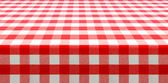 Table perspective view covered by red checked tablecloth — Stock Photo