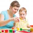 Stock Photo: Mother and son drawing or painting together isolated on white