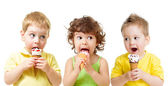 Funny kids boys and girl eating ice cream cone isolated on white — Stock Photo