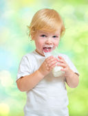 Child drinking dairy product from glass — Stock Photo