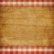 Cutting board over red grunge checked gingham picnic tablecloth  — Stock Photo #42032157