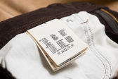Cotton clothing label or tag closeup — Stock Photo