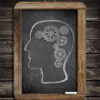 Human brain mechanism with cogs and gears drawn by chalk on blac — Stock Photo #42636645