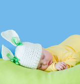 Sleeping baby closeup portrait in hare or rabbit hat with expand — Stock Photo