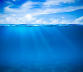 Sea or ocean water surface and underwater — Stock Photo