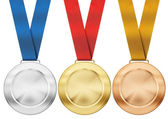 Gold, silver, bronze medals with ribbon isolated on white — Stock Photo