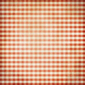 Red grunge checked picnic tablecloth background — Stock Photo