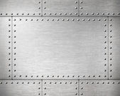 Metal plates with rivets background — Stock Photo