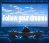 Follow your dreams phrase on cinema screen — Stock Photo
