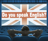 """Do you speak English?"" phrase on wide cinema screen — Stock Photo"
