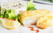 Fish fillet baked with cheese  and risotto with mushrooms — Foto de Stock