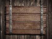 Medieval wood sign board over old wooden plaque — Stock Photo