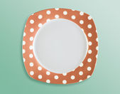 Retro style polka dot empty square plate top view — Stock Photo