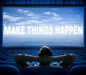 Make things happen phrase on cinema screen — Stock Photo