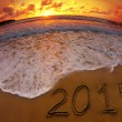 New year 2015 digits on ocean beach sunset — Stock Photo #45006233