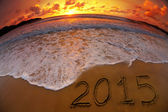 New year 2015 digits on ocean beach sunset — Stock Photo