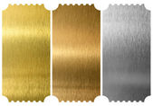 Aluminum, bronze and brass tickets isolated — Stock Photo