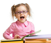 Funny kid girl in glasses with books speaking something isolated — 图库照片