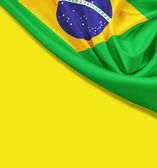 Flag of Brazil on yellow background. Clipping path for flag is i — Stock Photo