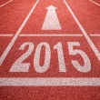New year 2015 diggits on sport track with arrow. Good start, gro — Stock Photo #47627093