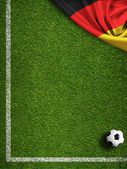 Soccer field with ball and flag of Germany — Stock Photo