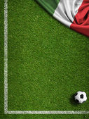 Soccer field with ball and flag of Italy — Stockfoto