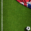 Soccer field with ball and flag of United Kingdom — Stock Photo #47840155