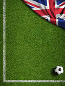 Soccer field with ball and flag of United Kingdom — Stock Photo