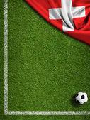 Fotbollsplan med bollen och schweiz flagga — Stockfoto