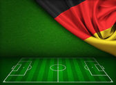Soccer or football field background with flag of Germany — Stock Photo