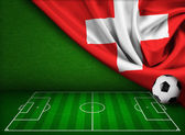 Soccer or football background with flag of Switzerland — Stock Photo