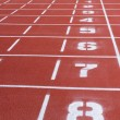 Rubber running tracks with numbers — Stock Photo #47982501