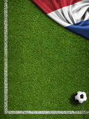 Soccer or football field with flag of Nederland — Stock Photo