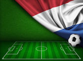 Soccer or football background with flag of Nederland — Stock Photo