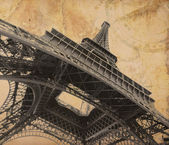 Eiffel tower over old adventure map — Stock Photo