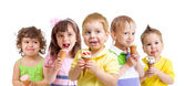 Happy kids with ice cream isolated — Stock Photo