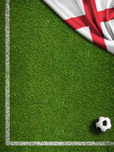 Soccer field with ball and flag of England — Stock Photo